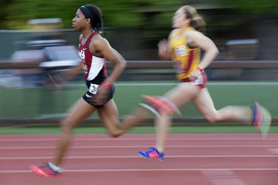 Stanford sprinter Olivia Baker, left, outdistances an opponent in a heat of the women's 800 meters during the Cardinal Classic at Angell Field, Friday, April 21, 2017, in Stanford, Calif. Photo: D. ROSS CAMERON, Special To The Chronicle
