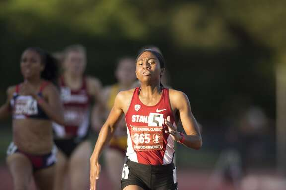 Stanford sprinter Olivia Baker, right, leads the pack to the finish line in a heat of the women's 800 meters, during the Cardinal Classic at Angell Field, Friday, April 21, 2017, in Stanford, Calif.