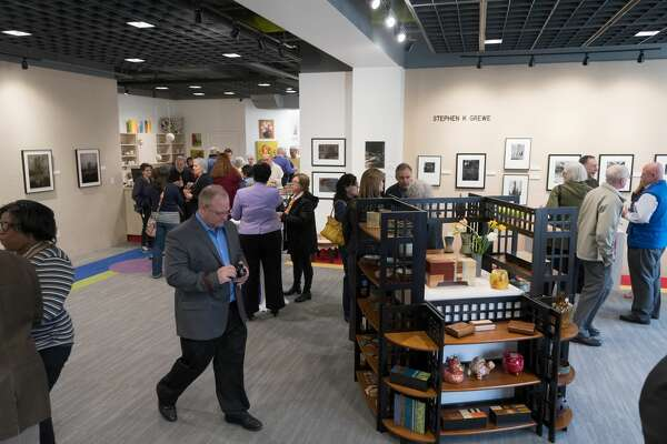 STEVEN SIMPKINS|for the Daily News The Northwood Gallery Ribbon Cutting Event Friday evening.