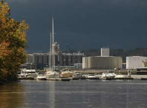 View of boats moored at the Albany Yacht Club in Rensselaer, Friday lunchtime Oct. 14, 2011. Silos at the Port of Albany can be seen in the background. (Will Waldron / Times Union)