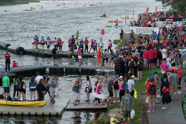 Triathletes compete in the swimming portion of the Ironman North American Championship, Saturday, April 22, 2017, in The Woodlands.