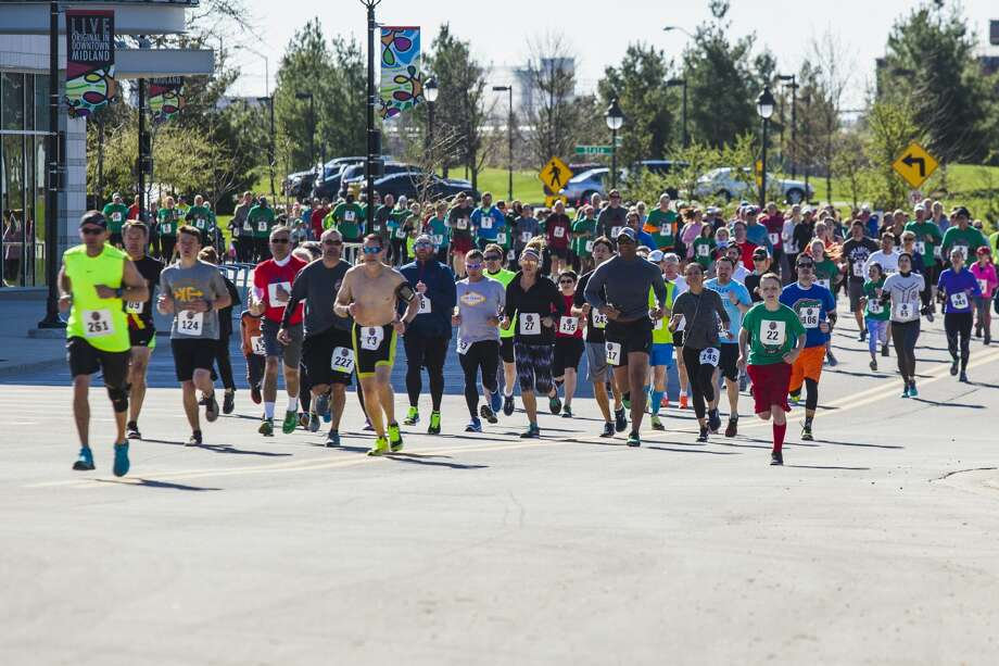 JOSIE NORRIS | for the Daily News Runners make their way along East Main Street as they compete in the Loons Pennant Race Saturday morning in Midland. Photo: Josie Norris/Midland Daily News