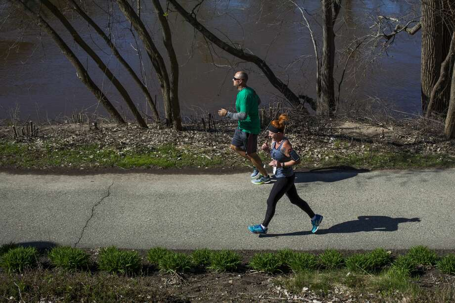 JOSIE NORRIS | for the Daily News Runners make their way along the rail trail as they compete in the Loons Pennant Race Saturday morning in Midland. Photo: Josie Norris/Midland Daily News