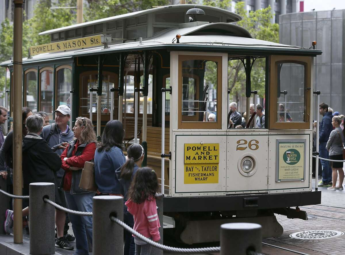 Passengers wait to board a cable car at Powell and Market streets in San Francisco, Calif. on Saturday, April 22, 2017. Muni may eliminate cash fares on board the world famous cable cars after a brakeman was accused of stealing the fares.
