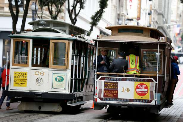 A cable car heads north up Powell Street towards Hyde and Beach streets in San Francisco, Calif. on Saturday, April 22, 2017. Muni may eliminate cash fares on board the world famous cable cars after a brakeman was accused of stealing the fares.