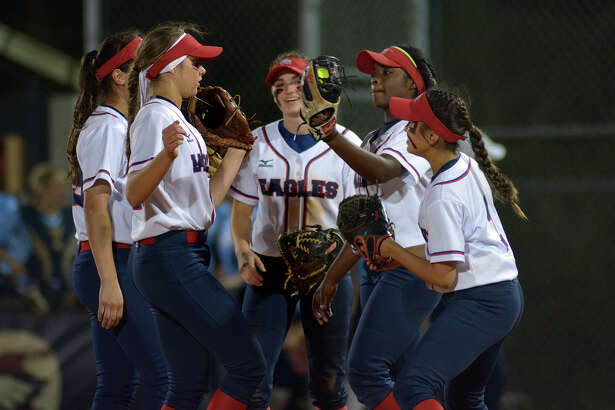 Atascocita senior pitcher Tierrah Williams, second from right, pumps up her infielders, including Skylar Wilabay, from left, Macie Pampell, Kimber Neal, and Sarah Cedillo, before the start of an inning against  Kingwood during their District 21-6A matchup at Atascocita High School on March 8, 2017. (Photo by Jerry Baker/Freelance)