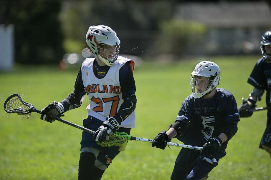 FILE — Petoskey's Caleb Gosciak defends Midland Orange 14UA's John Wagner during the Midland Lacrosse Club's Honor the Game tournament Saturday at Jefferson Middle School. Photo: Brittney Lohmiller/Midland Daily News/Brittney Lohmiller