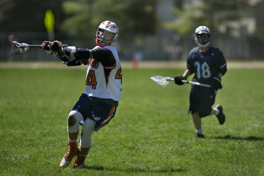 BRITTNEY LOHMILLER | blohmiller@mdn.net Midland Orange 14UA's Ryan Stadelmaier prepares to take a shot on Petoskey's goal during the Midland Lacrosse Club's Honor the Game tournament Saturday at Jefferson Middle School. Midland defeated Petoskey 11-3. Photo: Brittney Lohmiller/Midland Daily News/Brittney Lohmiller
