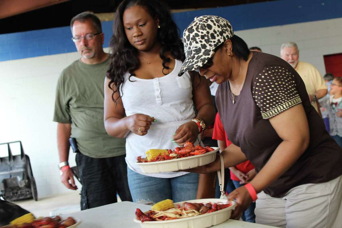 People line up for all-you-can-eat crawfish at the Humble Civic Arena on Friday, April 21. Proceeds from the event, hosted by the Humble Police Association, go to scholarships.