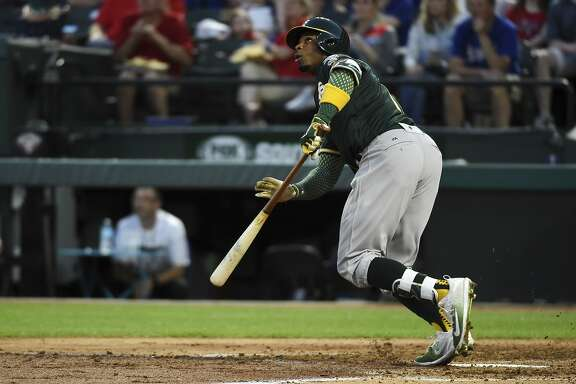 Oakland Athletics' Rajai Davis watches a fly ball he hit off of Texas Rangers starting pitcher Yu Darvish in the third inning of a baseball game, Saturday, April 8, 2017, in Arlington, Texas. (AP Photo/Jeffrey McWhorter)