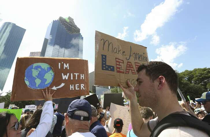 Thousands of people bring signs or dressed up to participate March for Science to support science Saturday, April 22, 2017, in Houston. The march began from Sam Houston Park and ended at City Hall. ( Yi-Chin Lee / Houston Chronicle )