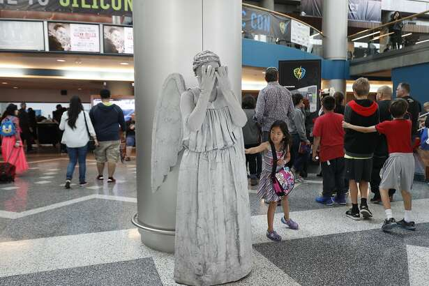 "Eve Dowdell, 7, of San Jose, touch to see if ""Weeping Angel"" Roxanne Weir of Utah is real at Santa Clara Comic Con on Saturday, April 22, 2017 in San Jose , CA."