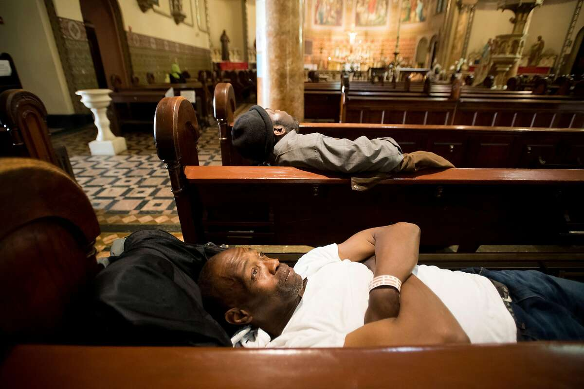 Anthony Wilburn rests at St. Boniface Catholic Church, where the Gubbio Project lets homeless people sleep in pews during the day, on Friday, April 21, 2017, in San Francisco. Wilburn, who now has a home, said he finds comfort revisiting the church that sheltered him when he was homeless last year.