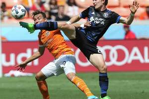 Houston Dynamo forward Erick Torres (9) battles with San Jose Earthquakes midfielder Florian Jungwirth (23) for control of the ball during the first half of the game at BBVA Compass Stadium Saturday, April 22, 2017, in Houston.