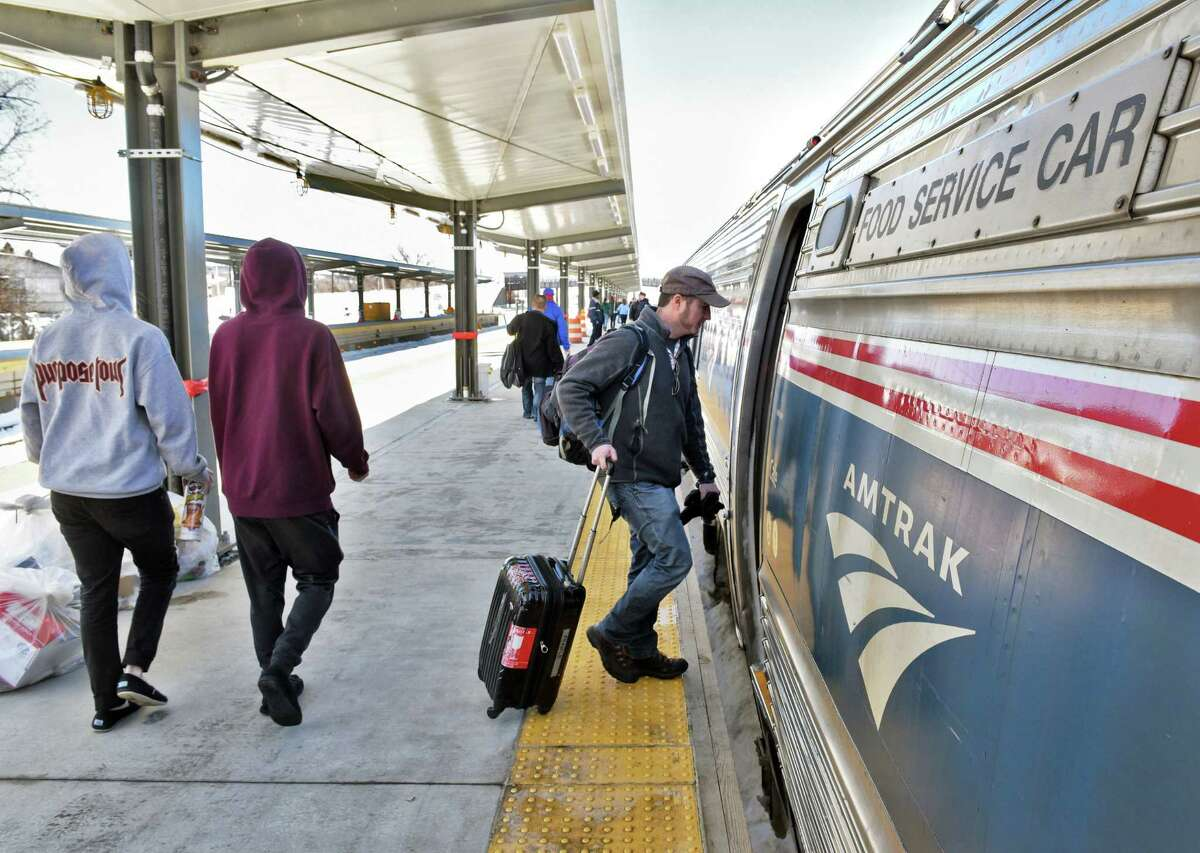 Passengers on the newly extended station platform board the Lake Shore Limited at the Rensselaer Amtrak station Friday March 17, 2017 in Rensselaer, NY. The Lake Shore Limited is one of several Amtrak long-distance services that will reduce operations to three days a week. It serves Boston, New York City and Chicago from Albany-Rensselaer. (John Carl D'Annibale / Times Union)