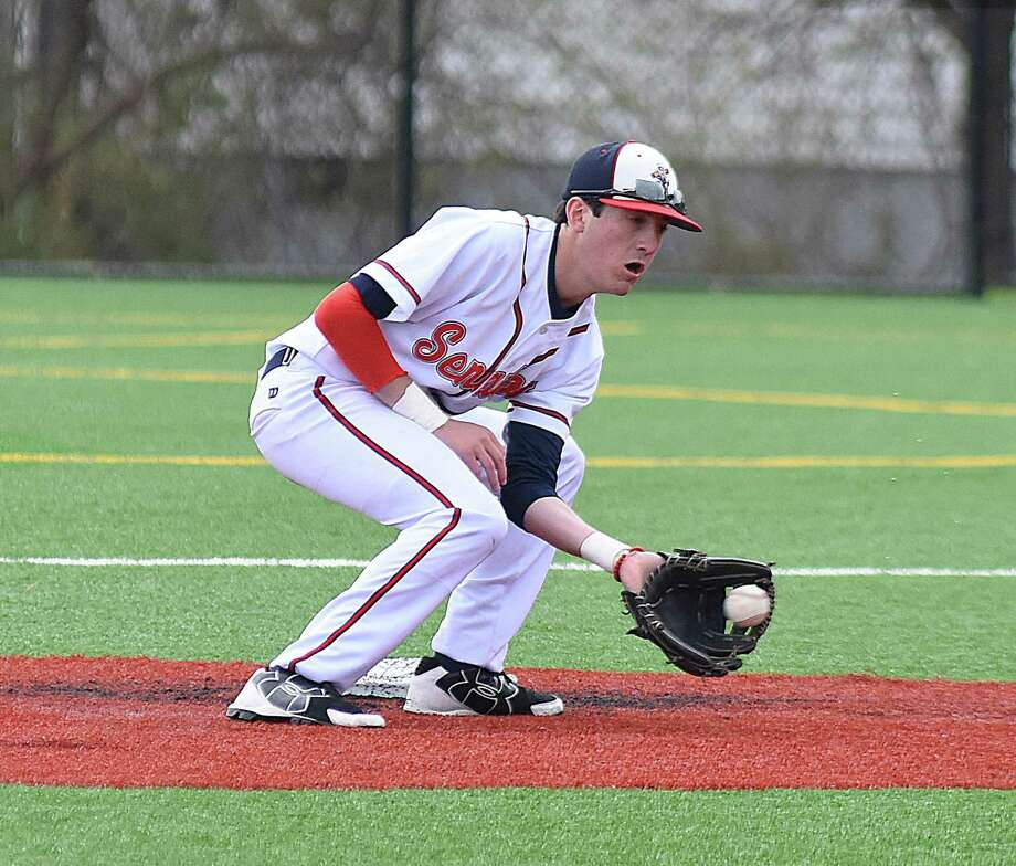 Brien McMahon shortstop Chris Giordano fields a throw to second base on a failed stolen base attempt during Saturday's game at Nathan Hale Middle School field in Norwalk. Photo: John Nash / Hearst Connecticut Media / Norwalk Hour
