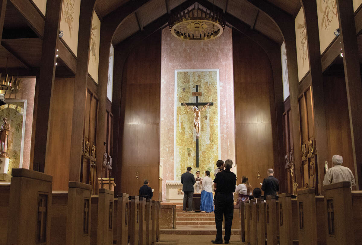 Glenn Hunter, 29, and Ashley Hunter, 27, say their vows in font of Rev. Kristopher Fuchs on April 13 in Victoria, Texas.