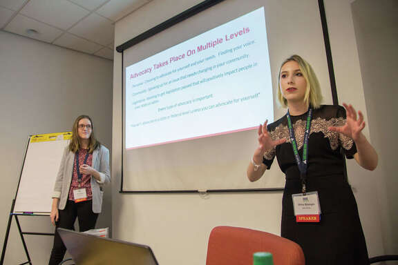 Emily Muller, left, and Shira Strongin, both 17, give their presentation on advocacy at the Rare Disease Legislative Advocates conference in Washington, D.C., in February..