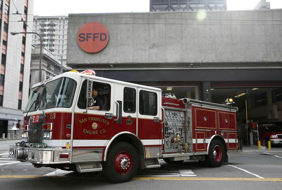 Firefighter Willa Ortega backs a fire engine into Station 13 on Sansome Street in San Francisco. Supervisor Aaron Peskin plans to submit legislation allowing housing units to be built above the fire station in the densely populated Financial District. Photo: Paul Chinn, The Chronicle