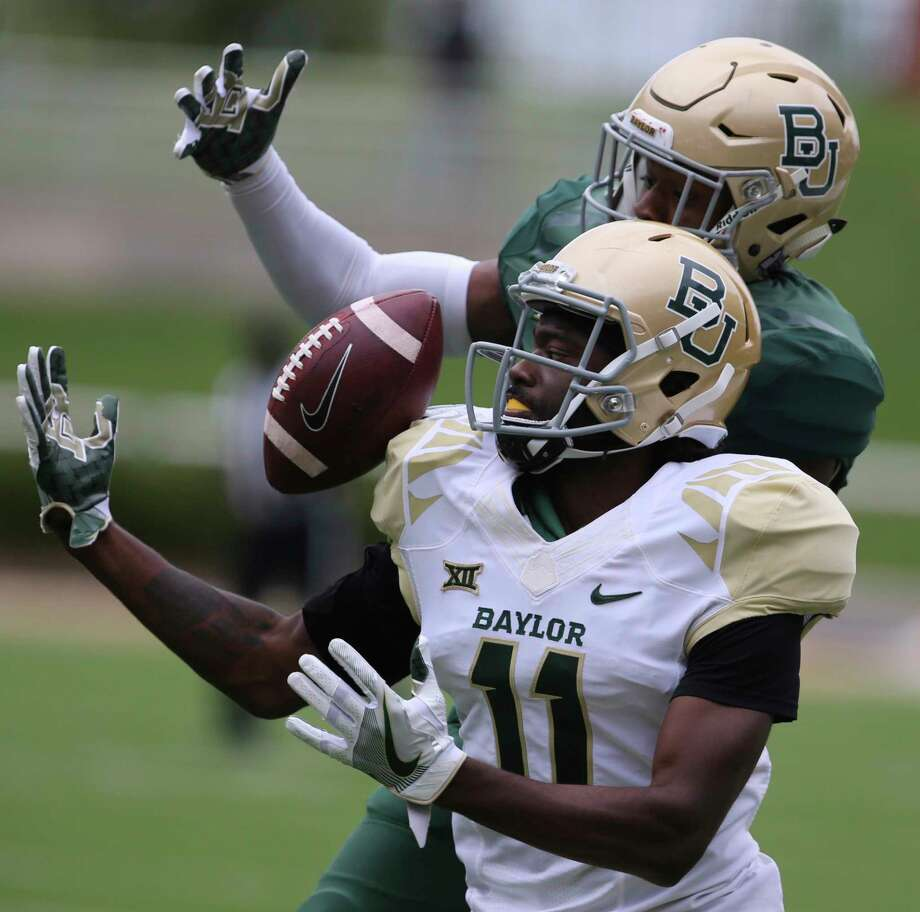 Baylor wide receiver Pooh Stricklin (11) attempts a catch as safety Jourdan Blake (23) defends during the first half of the NCAA college football team's Green and Gold spring game, Saturday, April 22, 2017, in Waco, Texas. (Rod Aydelotte/Waco Tribune Herald via AP) Photo: Rod Aydelotte, MBO / Waco Tribune-Herald