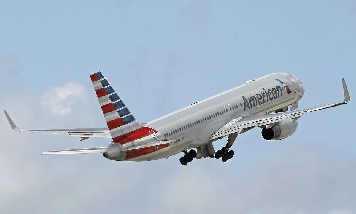 FILE - In this Friday, June 3, 2016 file photo, an American Airlines passenger jet takes off from Miami International Airport in Miami. The company said it grounded a flight attendant who got into a verbal confrontation with a passenger after taking a baby stroller away from another passenger on a Friday, April 21, 2017 flight from San Francisco to Dallas-Fort Worth. (AP Photo/Alan Diaz)