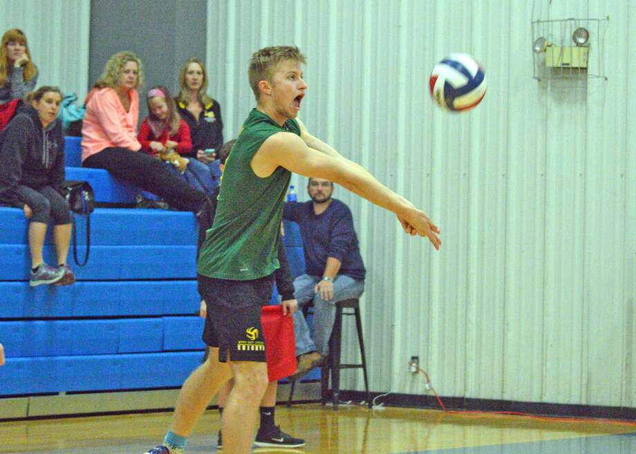 Metro-East Lutheran senior Stephen Korte receives a serve during a pool play match against Lutheran South on Saturday in the Cougar Invitational at Lutheran St. Charles.