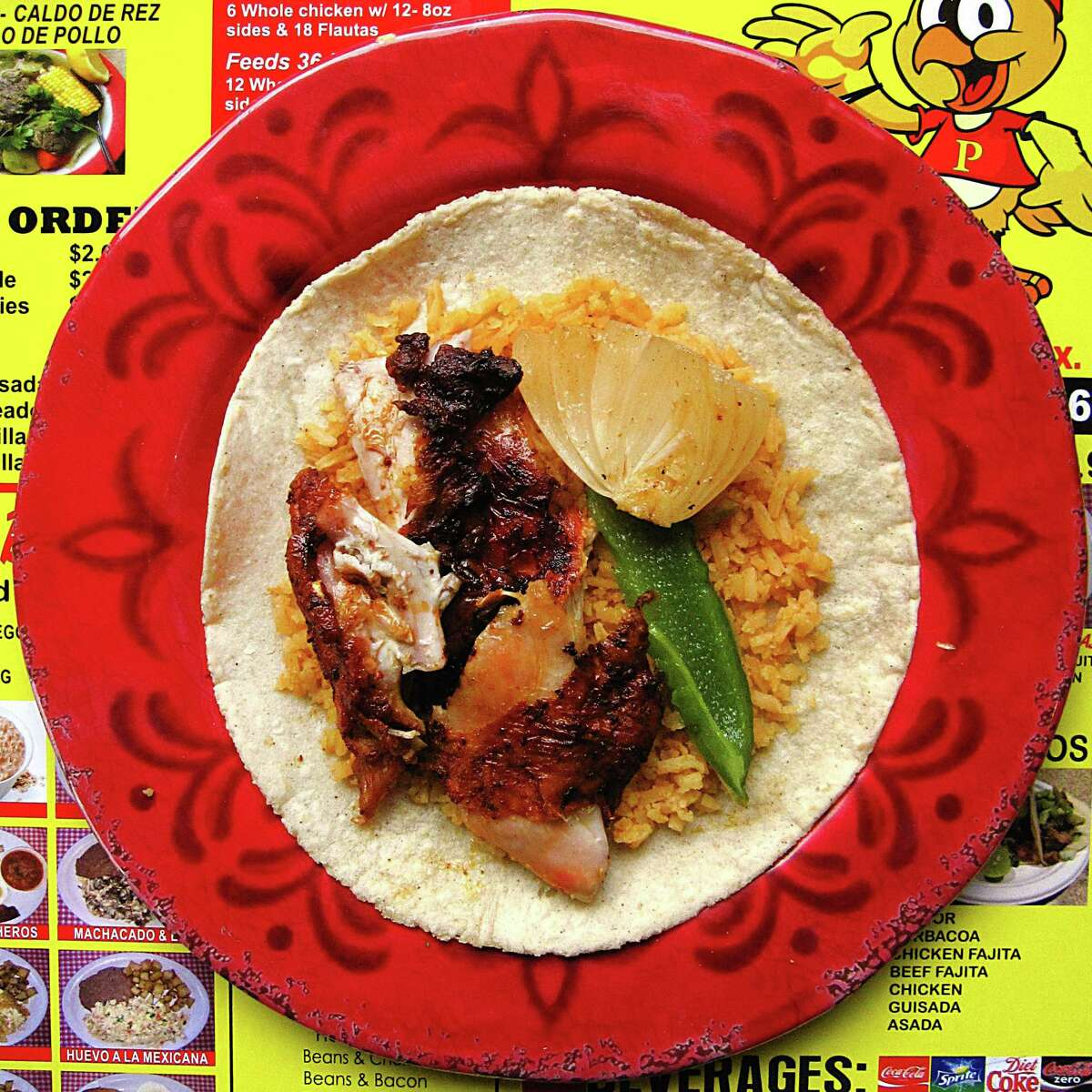 Do-it-yourself pollos asados taco bult with chicken, rice, grilled onion and grilled pepper on a handmade corn tortilla from Super Pollos Asados Los Primos on Culebra Road.