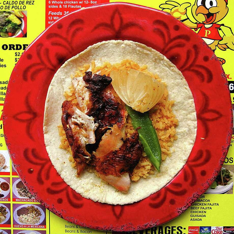 Do-it-yourself pollos asados taco bult with chicken, rice, grilled onion and grilled pepper on a handmade corn tortilla from Super Pollos Asados Los Primos on Culebra Road. Photo: Mike Sutter /San Antonio Express-News