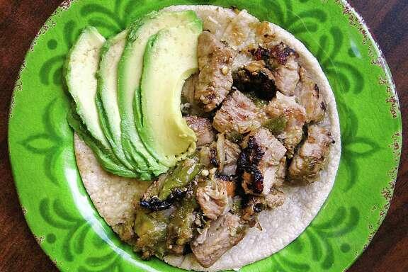 Pork with chile verde taco with avocado on a handmade corn tortilla from El Paraiso de Jalisco.