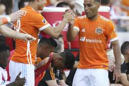 Houston Dynamo midfielder Alex (14) forward Erick Torres (9) as he is subbed during the second half of the game at BBVA Compass Stadium Saturday, April 22, 2017, in Houston. The Dynamo defeated the Earthquakes 2-0. ( Yi-Chin Lee / Houston Chronicle )