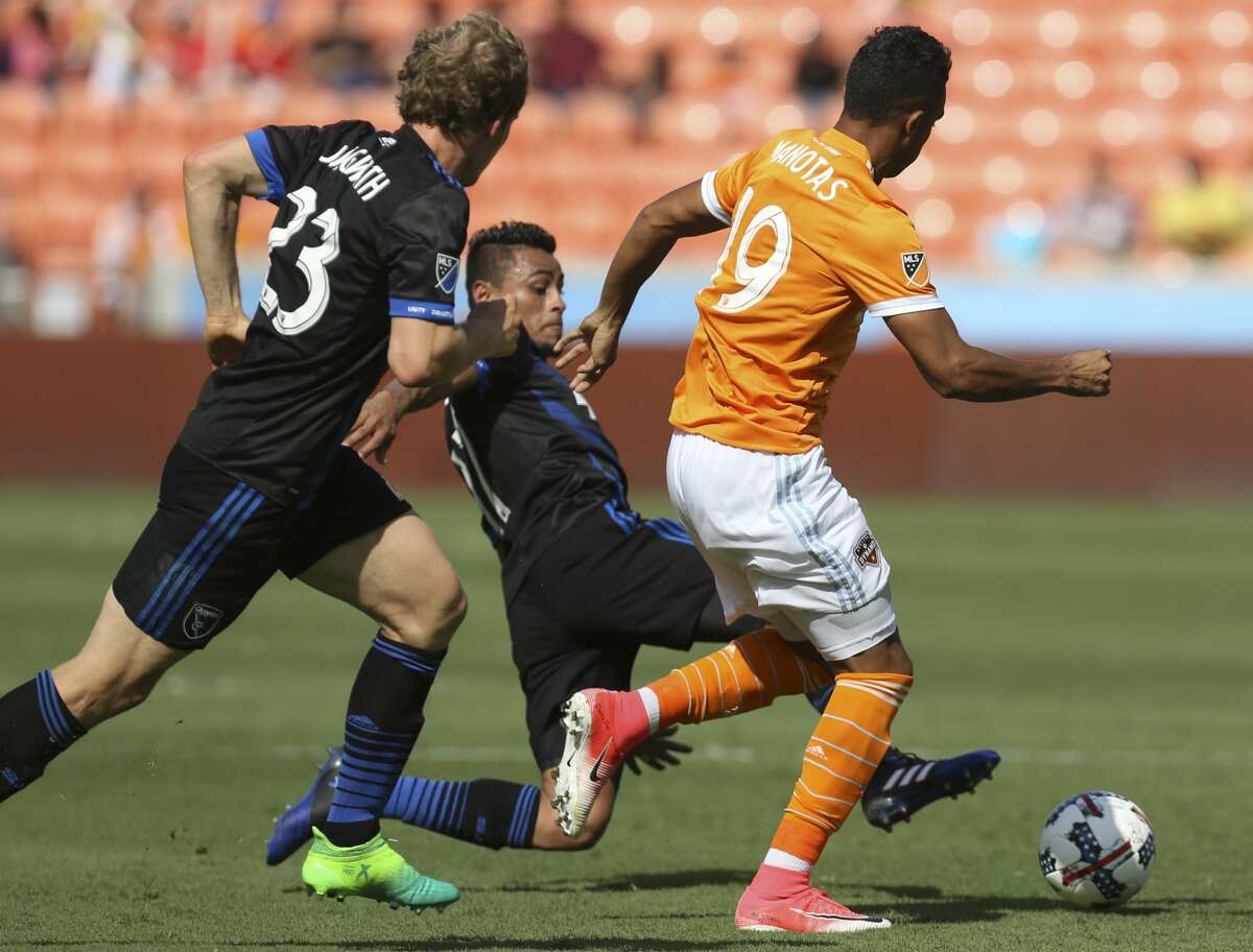 San Jose Earthquakes midfielder Darwin Ceren (17) slides the ball away from Houston Dynamo forward Mauro Manotas (19) during the second half of the game at BBVA Compass Stadium Saturday, April 22, 2017, in Houston. The Dynamo defeated the Earthquakes 2-0. ( Yi-Chin Lee / Houston Chronicle )