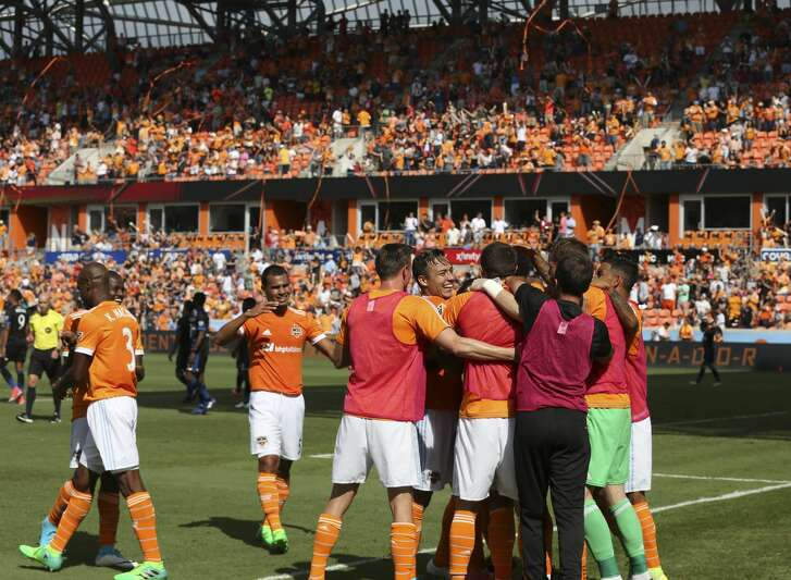 Houston Dynamo gather to celebrate the goal made by midfielder DaMarcus Beasley (7) during the second half of the game at BBVA Compass Stadium Saturday, April 22, 2017, in Houston. The Dynamo defeated the Earthquake 2-0. ( Yi-Chin Lee / Houston Chronicle )