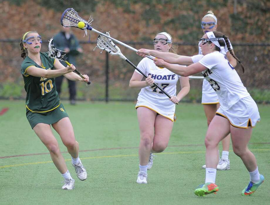 Greenwich Academy Anna Khoury passes off under pressure from Choate Ellen Arena and Kristina Schuler in a varsity girls lacrosse game at Greenwich Academy in Greenwich, Conn. on Saturday, April 22, 2017. Greenwich Academy was handed their first loss of the season by Choate, losing 13-8. Photo: Matthew Brown / Hearst Connecticut Media / Stamford Advocate
