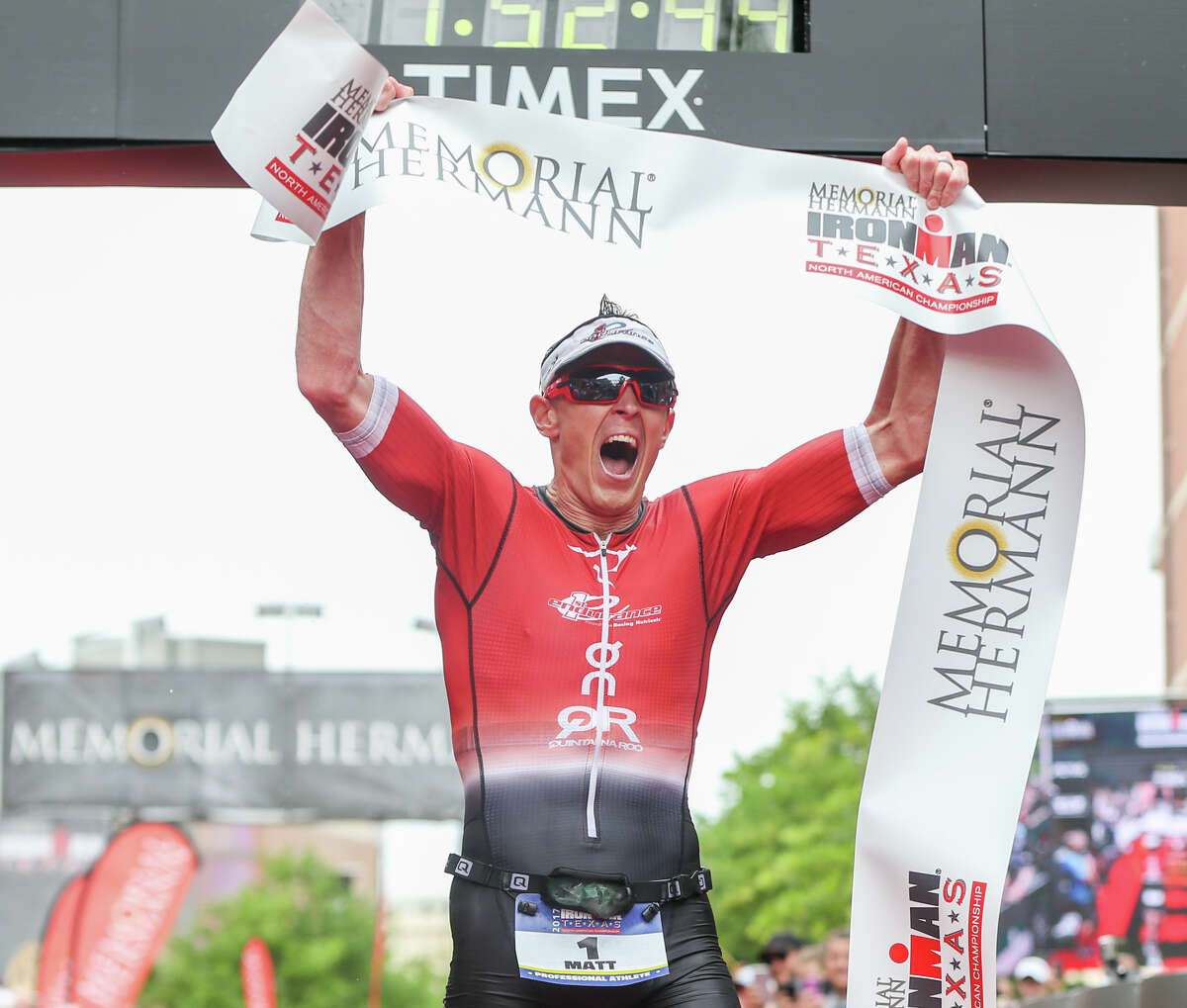 Matt Hanson, of Iowa, celebrates placing first during the Memorial Hermann IRONMAN North American Championship Texas on Saturday, April 22, 2017, in The Woodlands.