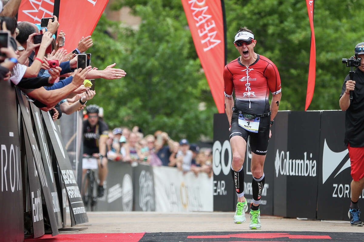 Matt Hanson, of Iowa, yells in jubilation as he approaches the finish line in first place during the Memorial Hermann IRONMAN North American Championship Texas on Saturday, April 22, 2017, in The Woodlands.