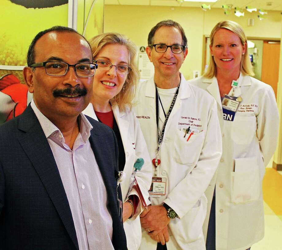 Members of the Stamford Health emergency team, from left: Dr. Arun Nandi, chair of the department of emergency medicine; Dr. Heather Machen, director of pediatric emergency medicine; Dr.  Gerald Rakos, chair of department of pediatrics; and Maureen McCauley, nurse manager for emergency medicine. A nautical theme featuring fish in wall art and mobiles runs throughout the unit. Photo: John Breunig / Hearst Connecticut Media / Stamford Advocate