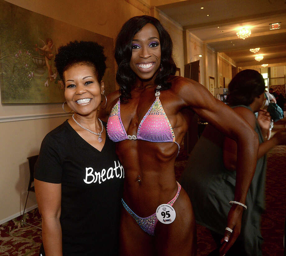 Daphne Kirvin and Chioma Onyejiaka were at the 2017 Southeast Texas Championship bodybuilding event at the Julie Rogers Theatre Saturday. Men and women of all ages took to the stage, modeling their physiques in hopes of winning the top trophies in various classes, including bikini, fitness, and bodybuilding.  This is the second competition and fitness expo that National Physique Committee has held in Beaumont since 1996, with Saturday's event being a national qualifier for advanced competitions. Photo taken Saturday, April 22, 2017 Kim Brent/The Enterprise Photo: Kim Brent / BEN