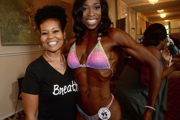 Daphne Kirvin and Chioma Onyejiaka were at the 2017 Southeast Texas Championship bodybuilding event at the Julie Rogers Theatre Saturday. Men and women of all ages took to the stage, modeling their physiques in hopes of winning the top trophies in various classes, including bikini, fitness, and bodybuilding.  This is the second competition and fitness expo that National Physique Committee has held in Beaumont since 1996, with Saturday's event being a national qualifier for advanced competitions. Photo taken Saturday, April 22, 2017 Kim Brent/The Enterprise