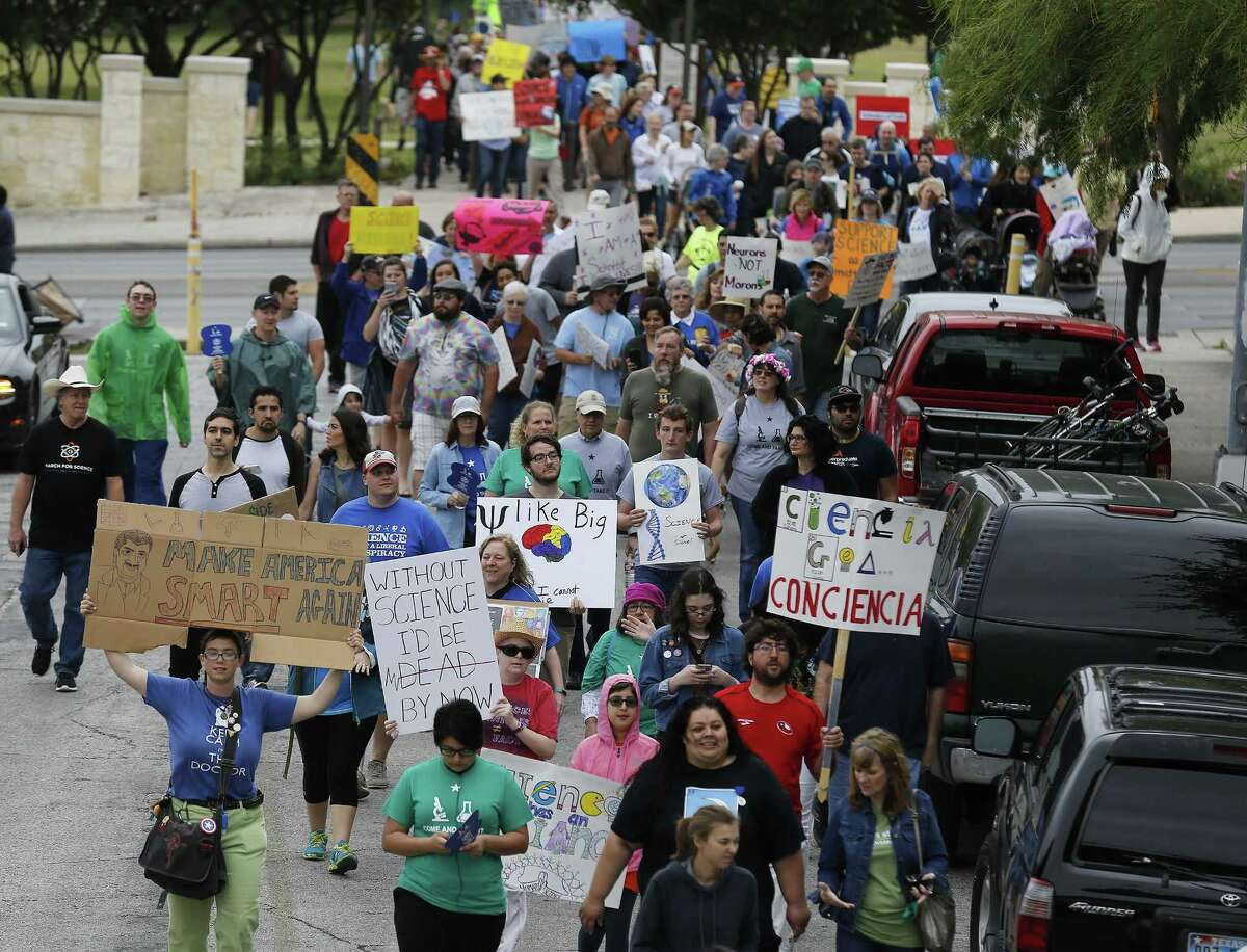 """A crowd gathers to """"March for Science"""" at San Pedro Springs Park on Saturday, Apr. 22, 2017 in conjunction with Earth Day and with other marches planned around the country including Washington, D.C. """"We wanted to make today a day to highlight, to celebrate and to protect scientific research and education in San Antonio and beyond,"""" said march organizer Sarah Stafford. The march started at the park and wound around the San Antonio College campus and at one point marchers passed the Scobee Education Center which houses a planetarium as well as the Challenger Center which provides students in science, technology, engineering and math (STEM) programs a hands-on approach to solving real-world problems. The march concluded with speakers from the field to science as the crowd cheered, """"Science not silence!"""" (Kin Man Hui/San Antonio Express-News)"""