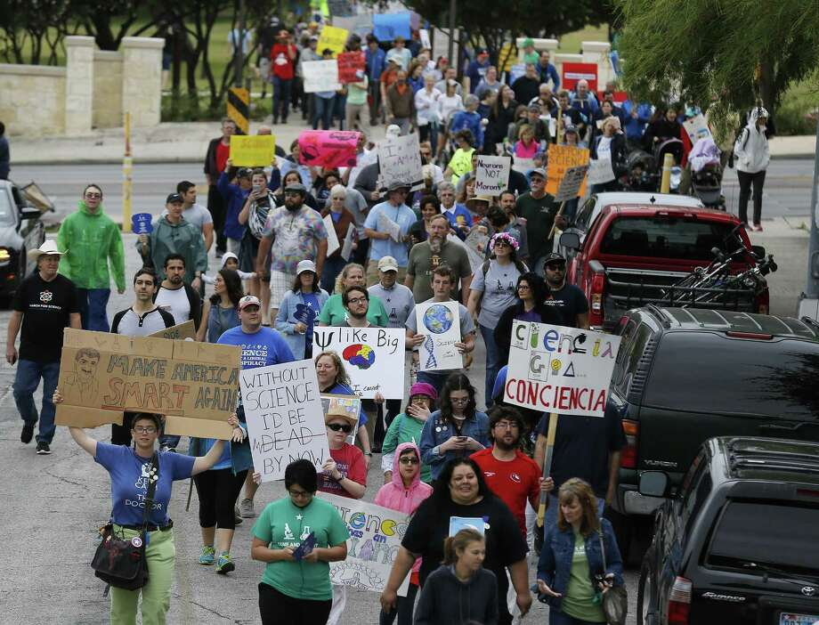 """A crowd gathers to """"March for Science"""" at San Pedro Springs Park on Saturday, Apr. 22, 2017 in conjunction with Earth Day and with other marches planned around the country including Washington, D.C. """"We wanted to make today a day to highlight, to celebrate and to protect scientific research and education in San Antonio and beyond,"""" said march organizer Sarah Stafford. The march started at the park and wound around the San Antonio College campus and at one point marchers passed the Scobee Education Center which houses a planetarium as well as the Challenger Center which provides students in science, technology, engineering and math (STEM) programs a hands-on approach to solving real-world problems. The march concluded with speakers from the field to science as the crowd cheered, """"Science not silence!"""" (Kin Man Hui/San Antonio Express-News) Photo: Kin Man Hui, Staff / San Antonio Express-News / ©2017 San Antonio Express-News"""