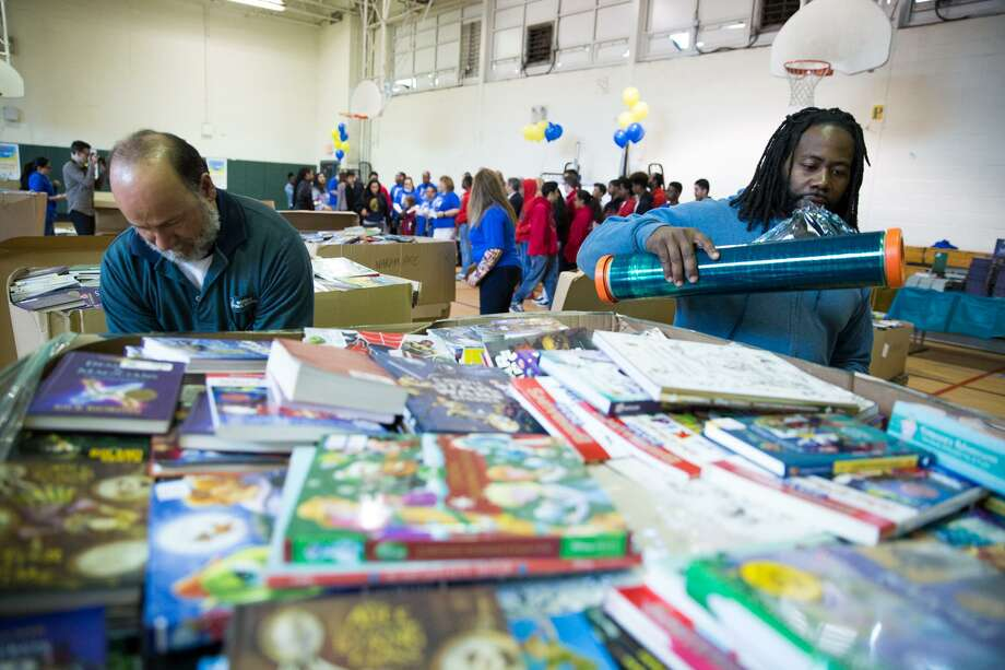 Luis Figueroa and Sharod Blackwell pack up a pallet of books to be sent to Marvin Elementary school as part of the 40,000 books provided to the school district at Ponus Ridge Middle School in Norwalk, Conn. on Saturday, April 22, 2016. Photo: Chris Palermo / For Hearst Connecticut Media / Norwalk Hour Freelance