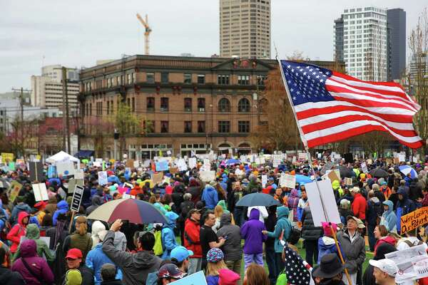 Thousands of demonstrators participate in the March for Science, which traveled through downtown Seattle from Cal Anderson Park to the Seattle Center, April 22, 2017. People in cities around the world spent the day rallying in support of science, truth and facts.