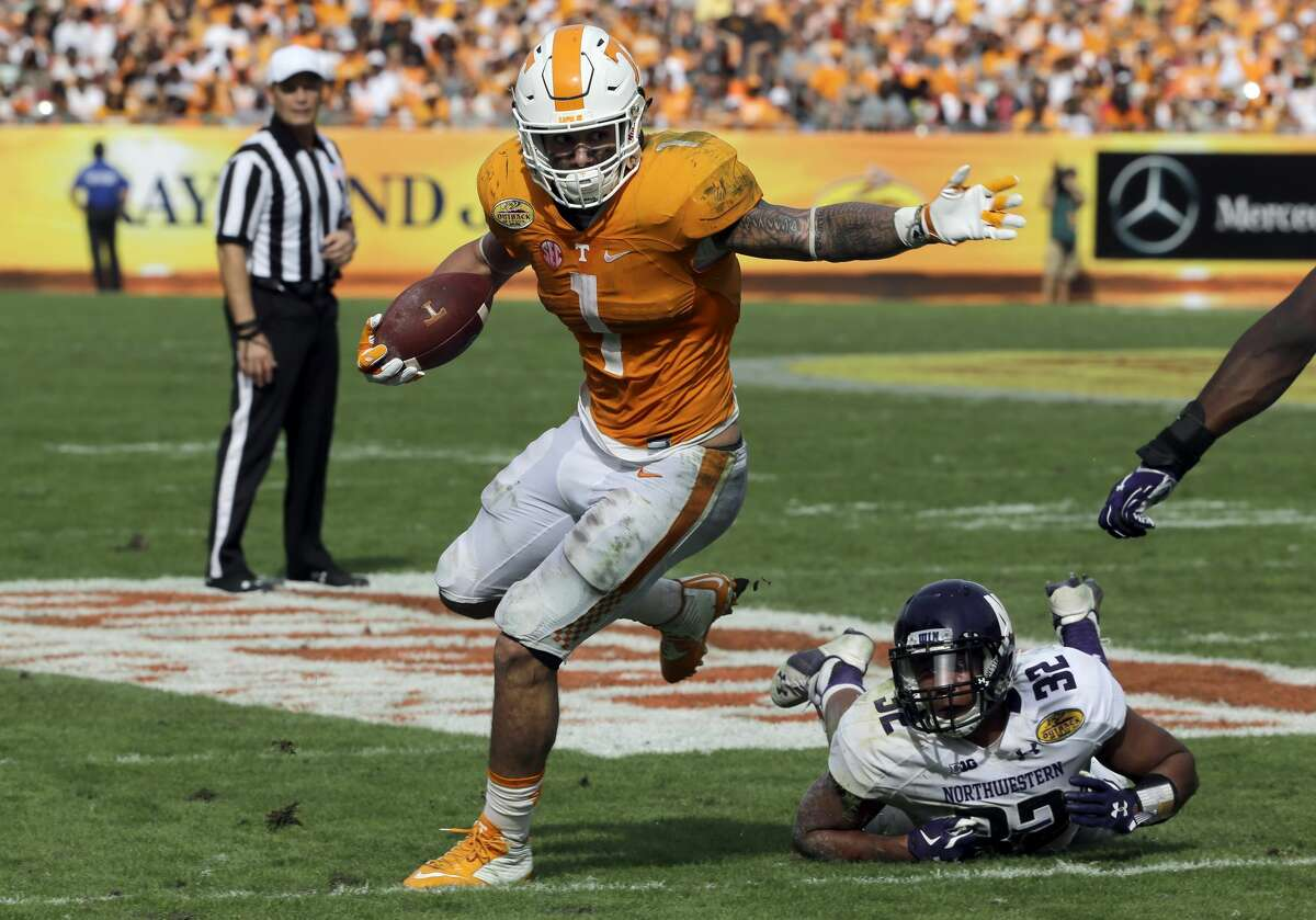 Tennessee running back Jalen Hurd (1) slips away from Northwestern linebacker Nate Hall (32) during the third quarter of the Outback Bowl NCAA college football game Friday, Jan. 1, 2016, in Tampa, Fla. (AP Photo/Chris O'Meara)