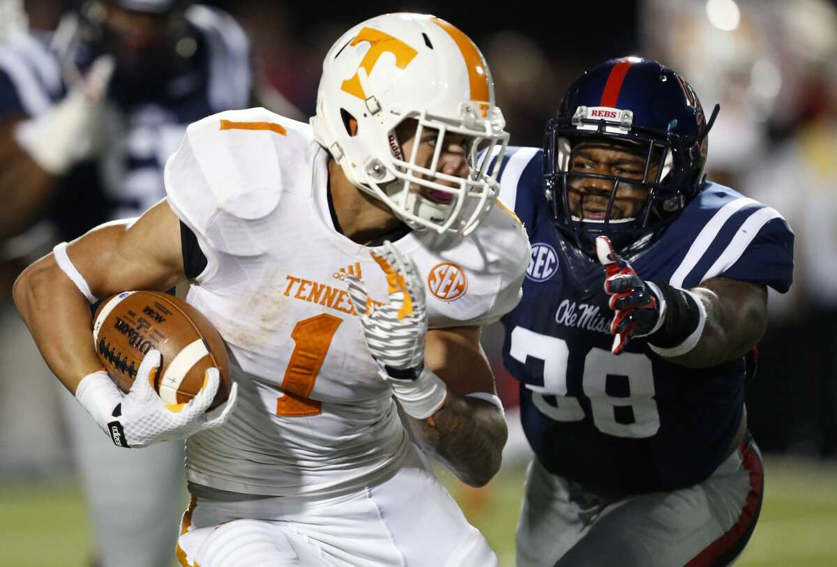 FILE - In this Oct. 18, 2014, file photo, Tennessee running back Jalen Hurd (1) runs away from Mississippi linebacker Deterrian Shackelford (38) in the second half of an NCAA college football game in Oxford, Miss. No. 3 Mississippi has had a dominant defense that is giving up barely 10 points per game. (AP Photo/Rogelio V. Solis, File)