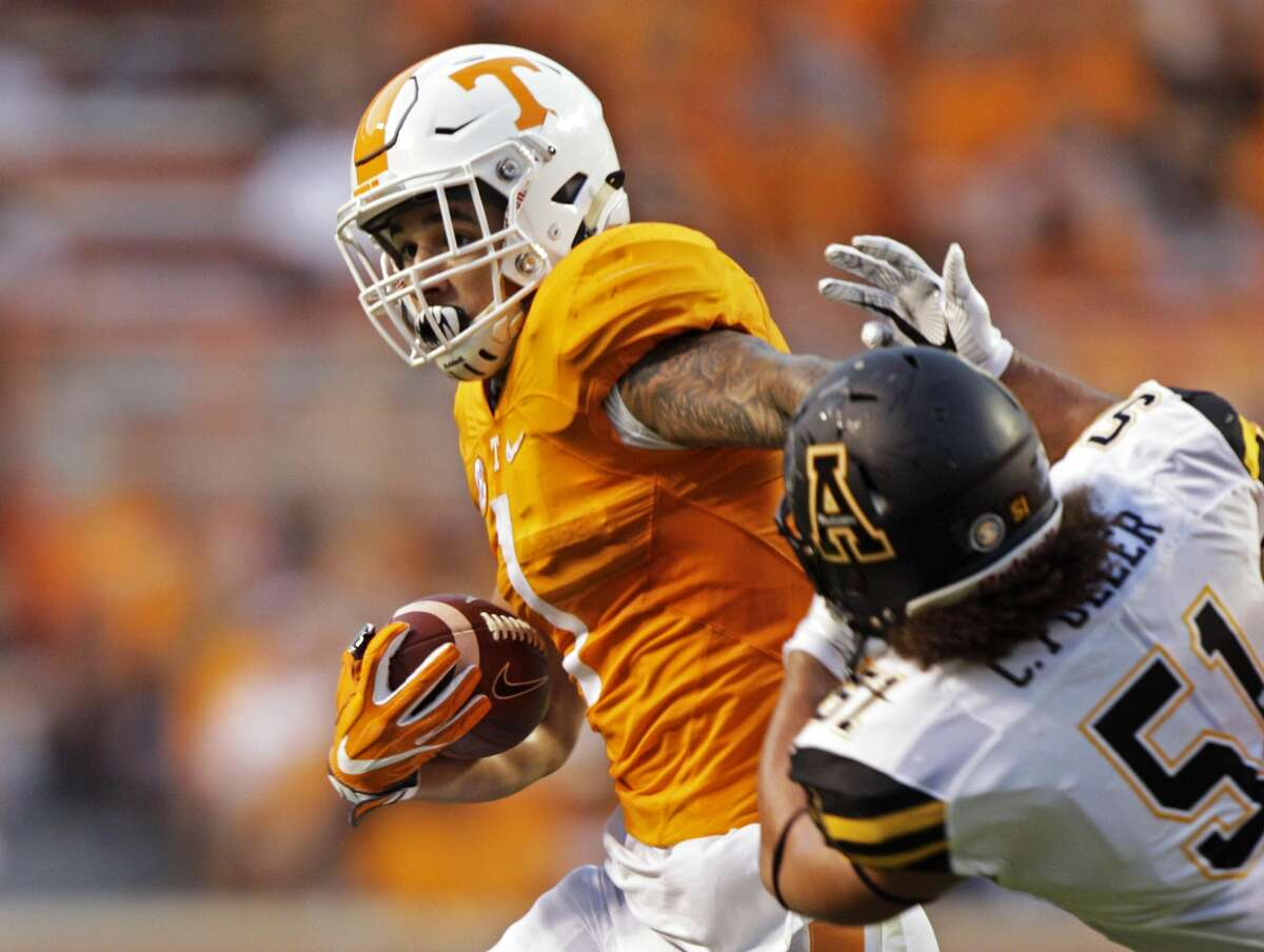 Tennessee running back Jalen Hurd (1) escapes from Appalachian State defensive lineman Caleb Fuller (51) during the first half of an NCAA college football game Thursday, Sept. 1, 2016 in Knoxville, Tenn. (AP Photo/Wade Payne)