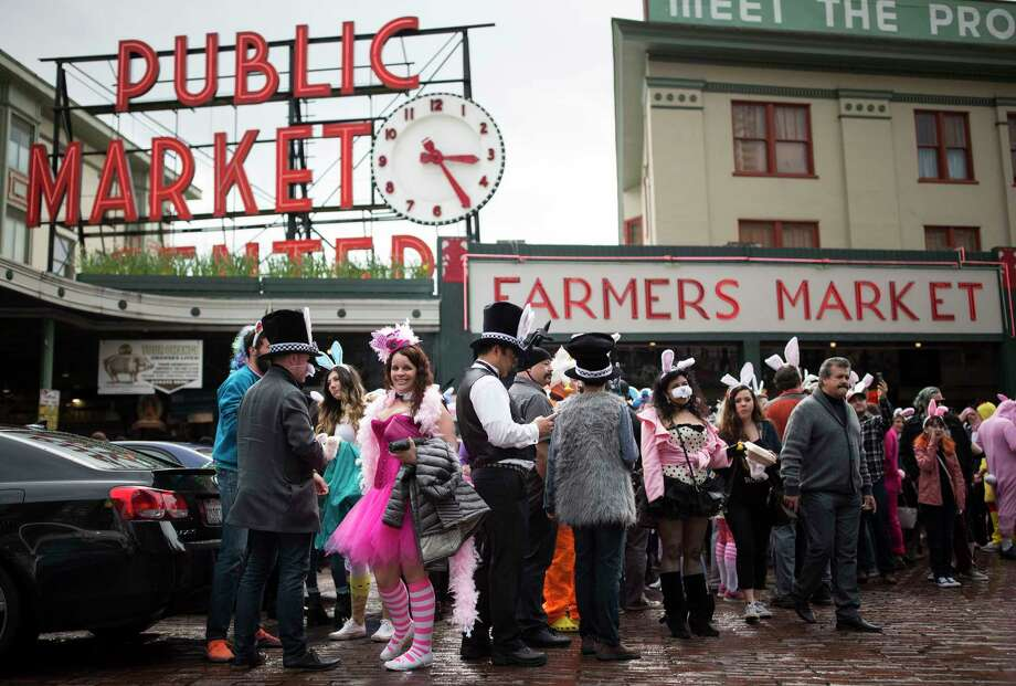 Participants gather at the Pike Place Market sign to take a group photo during the 7th annual BunnyCon bar hop in in Seattle on Saturday, April 22, 2017. Hundreds of bunnies (and some carrots) hopped their way through a dozen downtown Seattle bars during the nearly 15 hour event. Photo: Lindsey Wasson, SeattlePI.com / Other