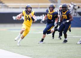 Cal Quarterback Chase Forrest (14) runs the ball during the Cal Football Spring Game on Saturday April 22, 2017 in Berkeley, Calif.