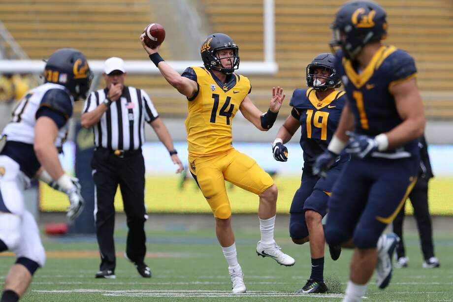 Quarterback Chase Forrest (14) throws the ball while on the move during the Cal Football Spring Game on Saturday April 22, 2017 in Berkeley, Calif. Photo: Al Sermeno / ISIPhotos