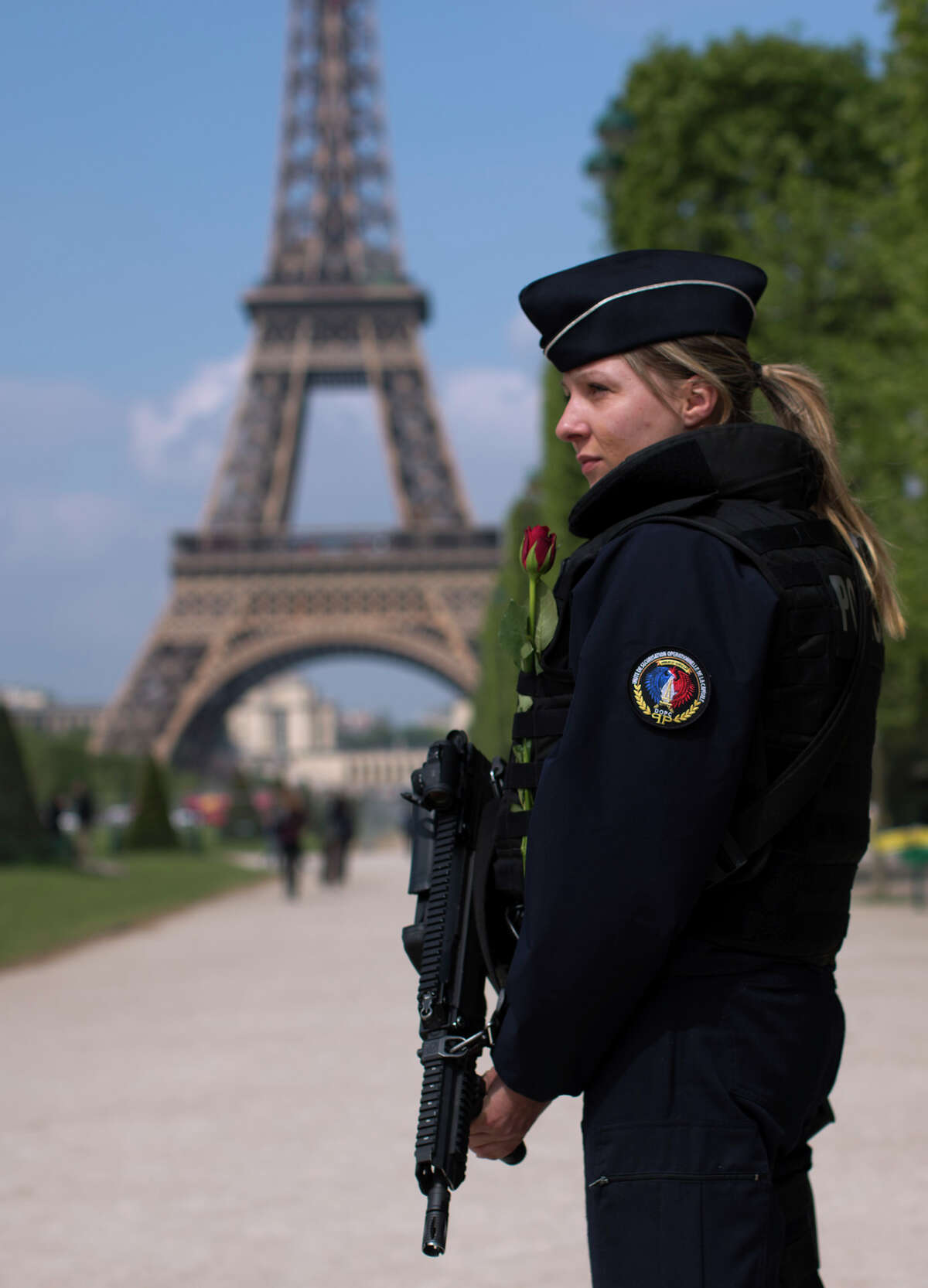 A French police officer patrols with the Eiffel Tower in background, in Paris, Saturday, April 22, 2017. The outcome of France's presidential election is being closely watched for signs that Europe is moving toward nationalist candidates who advocate the European Union's dissolution. The top two candidates from Sunday's vote in Paris will progress to a winner-takes-all May 7 runoff. (AP Photo/Emilio Morenatti)