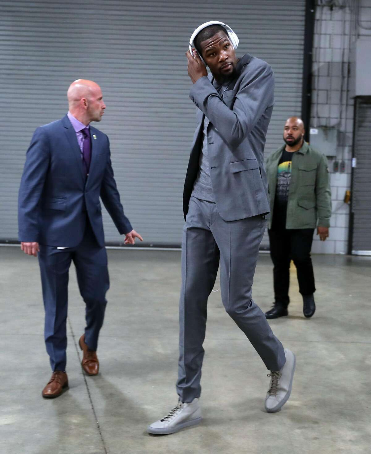 KD doesn't always go casual, however. For Game 3, he went with a slim-fitting grey suit, an outfit he also wore on the bench as he was sidelined with an injury.